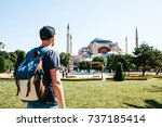 a traveling man with a backpack ... | Shutterstock . vector #737185414