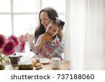 mom and daughter are having... | Shutterstock . vector #737188060
