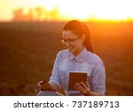 pretty young engineer woman...   Shutterstock . vector #737189713