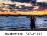 sunset girl looking at camera... | Shutterstock . vector #737194984