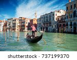 gondolier floats on the grand... | Shutterstock . vector #737199370