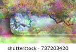 Small photo of The Fairies Oak Tree - Big old oak with a long twisted branch and an ethereal light in the atmosphere showing a fantasy rainbow colored aura and copy space