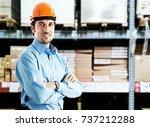 portrait of a warehouse worker | Shutterstock . vector #737212288