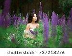 beautiful girl in white dress...   Shutterstock . vector #737218276