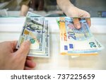 Small photo of Exchange money, Exchange US dollar or American dollars (USD) for EUR money, A man and women are exchanging dollars for euros.