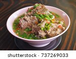 """Small photo of Delicious Thai spicy soup with Pork Ribs, this is popular food in Thailand and thai called """"TOM ZAP LENG or Super LENG"""""""