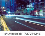 traffic trails in downtown hong ... | Shutterstock . vector #737294248