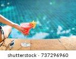 bikini woman in pool relaxing... | Shutterstock . vector #737296960
