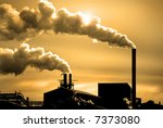 Detail of pollution coming from factory smoke stacks - stock photo