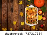 roasted turkey garnished with... | Shutterstock . vector #737317354