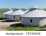 Mongolian yurts in the grassland of Hulun Buir League of Inner-Mongolia, China - stock photo
