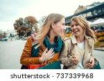 happy friends shopping. two...   Shutterstock . vector #737339968