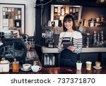 woman barista take order with... | Shutterstock . vector #737371870