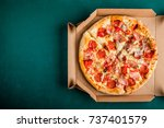 pizza in a cardboard box on a... | Shutterstock . vector #737401579