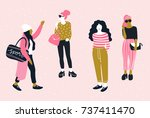 fashionable young women in... | Shutterstock .eps vector #737411470