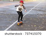 little urban boy with a penny... | Shutterstock . vector #737415370