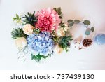 Small photo of Colorful wedding reception table arrangement. Flower composition of hydrangea, roses. Wedding decor.