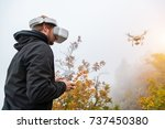 young man handling drone  using ... | Shutterstock . vector #737450380