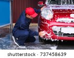 man cleaning automobile with... | Shutterstock . vector #737458639