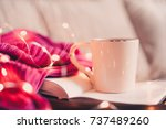cup of coffee staying on open... | Shutterstock . vector #737489260
