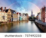 rainbow over canal in bruges... | Shutterstock . vector #737492233