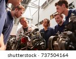 mechanic showing engines to... | Shutterstock . vector #737504164