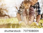 serious boy helping his dad to... | Shutterstock . vector #737508004
