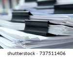stack of documents with binder... | Shutterstock . vector #737511406
