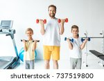 cheerful father and sons... | Shutterstock . vector #737519800