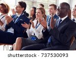 smiling audience applauding at... | Shutterstock . vector #737530093