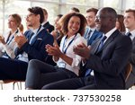 smiling audience applauding at... | Shutterstock . vector #737530258