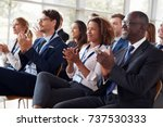 smiling audience applauding at... | Shutterstock . vector #737530333