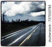 wet dark road with storm clouds ... | Shutterstock . vector #737533783