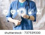 doctor pushing button gear... | Shutterstock . vector #737539330