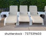 sunbeds to relax by the pool... | Shutterstock . vector #737539603