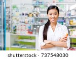 cheerful young asian pharmacist ... | Shutterstock . vector #737548030