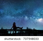 girl watching the stars in... | Shutterstock . vector #737548033