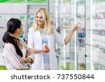 smiling pharmacist holding... | Shutterstock . vector #737550844