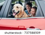 Stock photo happy kids sitting on backseats in car with dog 737588509