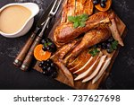 carved turkey on a cutting... | Shutterstock . vector #737627698