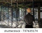 engineer working on building... | Shutterstock . vector #737635174
