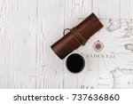 leather case and cup of coffee... | Shutterstock . vector #737636860