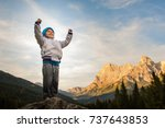 a child conquers the summit ... | Shutterstock . vector #737643853