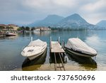 lake and mountains in lugano ... | Shutterstock . vector #737650696