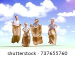 friends playing sack race... | Shutterstock . vector #737655760