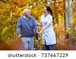 nurse helping elderly senior... | Shutterstock . vector #737667229