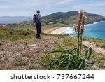 a pilgrim walking along the...   Shutterstock . vector #737667244