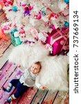 little baby lies on fluffy... | Shutterstock . vector #737669134