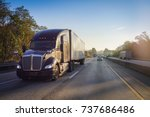 truck on road at sunrise | Shutterstock . vector #737686486