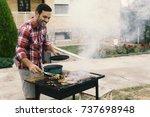 handsome young man preparing... | Shutterstock . vector #737698948